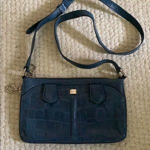 Blue leather Cole Haan expandable crossbody purse